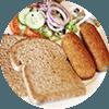 Twee Kwekkeboom kroketten met bruin brood